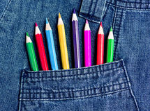 Jeans pocket with color pencils Royalty Free Stock Images