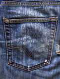 Jeans pocket dark background Stock Images