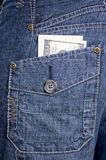 Jeans pocket dollars Stock Image