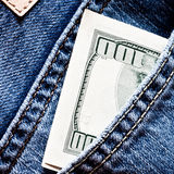 Jeans pocket with dollars banknotes Royalty Free Stock Photography