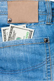 Jeans pocket with dollars banknotes Stock Photos