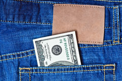 Jeans pocket with dollars banknotes Royalty Free Stock Images