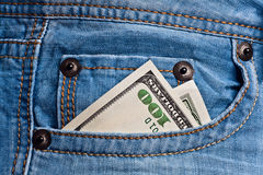 Jeans pocket with dollars banknotes Stock Images