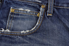 Jeans pocket. Frayed jeans pocket closeup for backgrounds Royalty Free Stock Photo