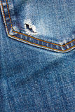 Jeans pocket with hole Stock Photos