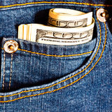 Jeans pocket with many banknotes Stock Images