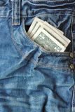 Jeans pocket and money. Blue jeans pocket and money Royalty Free Stock Photos