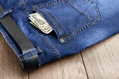 Jeans pocket with money Royalty Free Stock Photography
