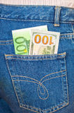 Jeans pocket with one hundred euro and one hundred american Royalty Free Stock Images