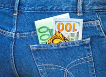 Jeans pocket with one hundred euro, one hundred american do Royalty Free Stock Photo