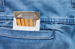 Jeans pocket with a packet of cigarettes Stock Photo