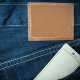 Jeans pocket and paper tag Royalty Free Stock Photo