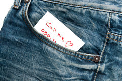 Jeans pocket with phone number note Royalty Free Stock Photo