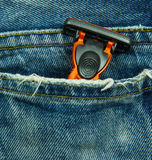 Jeans pocket with shaving razor Stock Photography