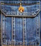 Jeans pocket with yellow button. Blue jeans pocket with lots of decorative seams and a yellow button Royalty Free Stock Images