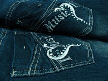 Jeans Pockets. Close-up of dark blue jeans pockets stock images