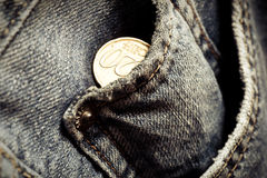 Jeans pockets with twenty cents coins Royalty Free Stock Photos