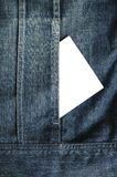 Jeans pouch and white paper Royalty Free Stock Images