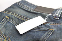 Jeans and price tag Stock Photography