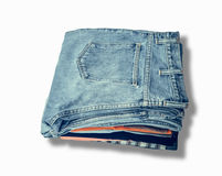 Jeans put on wooden. Pile of jeans put on a wooden background with space royalty free stock photo