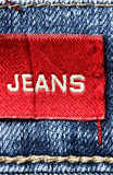 Jeans with red label. Blue jeans and red label with word Jeans Stock Photos