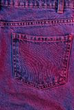 Jeans. Retro futurism background. Texture of crumpled pocket jeans with red-blue neon light. 80s stock photos