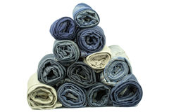 Jeans rolled up stacked in pyramid Stock Image