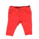 Jeans rouges d'enfant d'isolement au-dessus du blanc Photographie stock