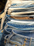 Jeans row. Row of hanged blue jeans in a shop royalty free stock image
