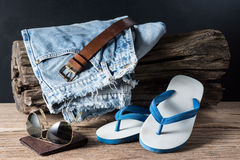 Jeans and rubber slippers Stock Photography