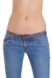 Jeans s'usants de fuselage de Womans au-dessus de blanc Photographie stock libre de droits