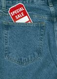 Jeans on sale. Jeans with special sale tag in pocket stock photos