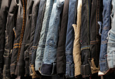 Jeans for sale. Hanging on a stall on market in Brixton Royalty Free Stock Image