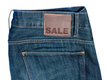 Jeans with Sale Sign royalty free stock photos