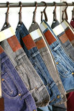 Jeans sale in store. Many colored fashion jeans sale in store Stock Photo