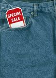 Jeans with sale tag. Jeans with special sale tag in pocket royalty free stock photo