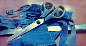 Jeans & scissors Stock Photography