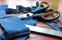 Jeans & scissors Stock Photos