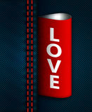 Jeans seam with red love label Royalty Free Stock Images
