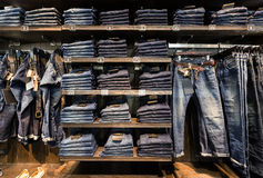 Jeans at shelf in the Royalty Free Stock Images