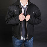 Jeans, shirt and jacket detail. Jeans, white shirt and black jacket, detail Stock Photography