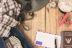 jeans, shirt, passports, banknote, sunglasses, airplane model royalty free stock images