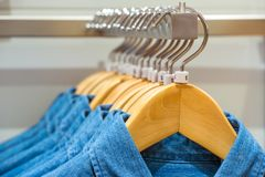 Jeans shirts on the hangers Royalty Free Stock Images