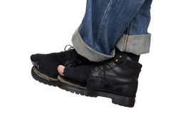 Jeans and shoes on white close up Royalty Free Stock Photos