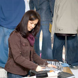 Jeans shop woman. Female shop assistant in a jeans shop, packing clothes behind the counter Royalty Free Stock Photos