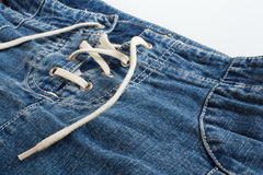 Jeans skirt with lacing close up Stock Images