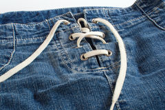 Jeans skirt with lacing close up Royalty Free Stock Image