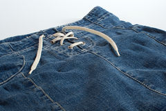 Jeans skirt with lacing close up Stock Image