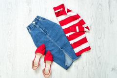 Jeans skirt, red shoes, white and red shirt, collage. Fashionable concept.  Royalty Free Stock Images