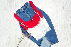 Jeans skirt, red and white top, collage. Fashionable concept Stock Image